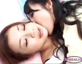 2 Asian Girls Kissing Sucking Tongues One Of Them Getting Her Tits Rubbed On The Couch
