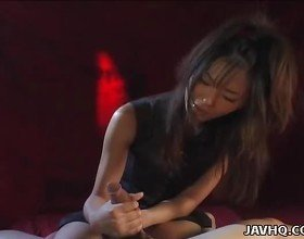 Hot Japanese babe gives a perfect handjob