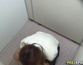 Asian teen rubs and pees